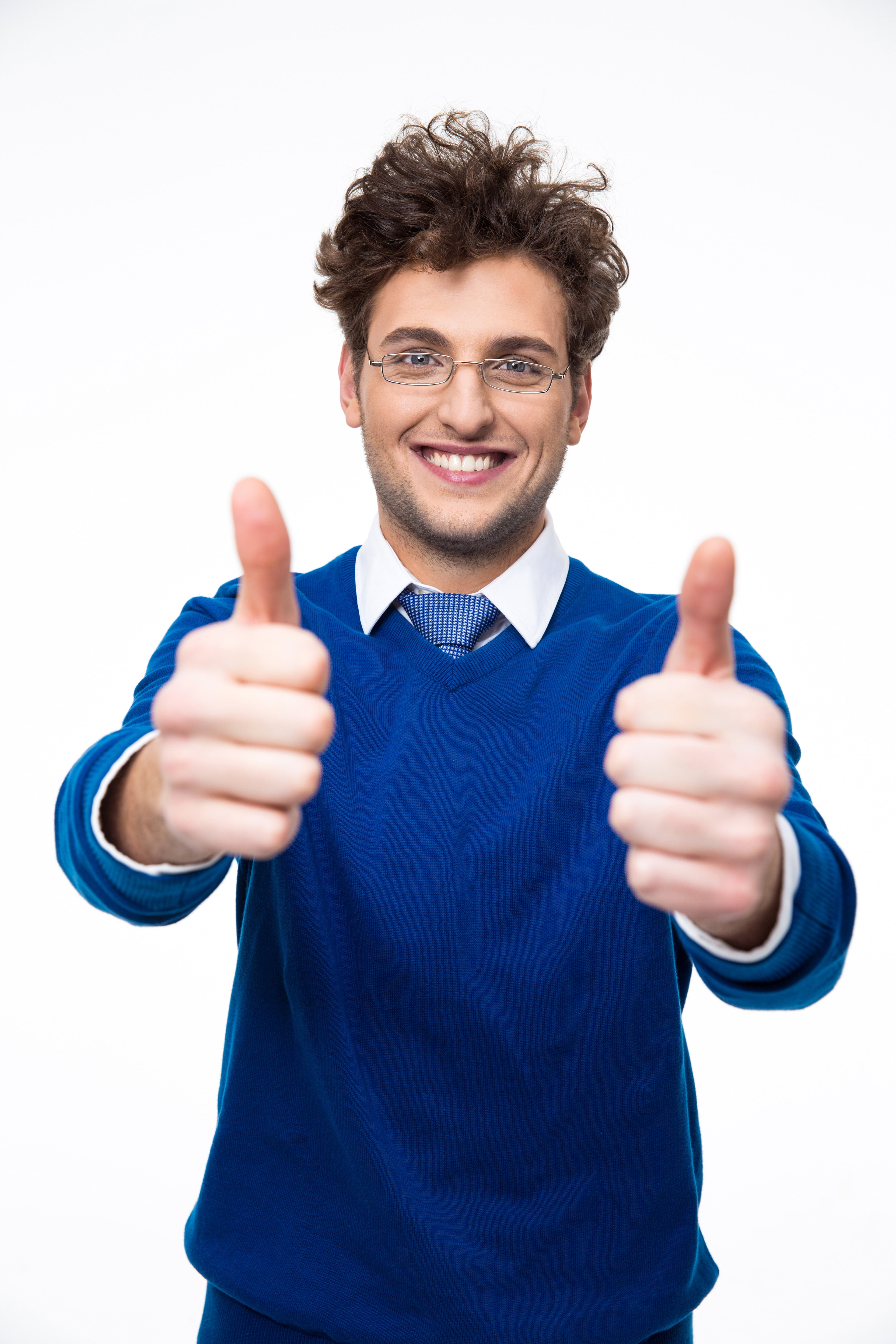Smiling business man with thumbs up over white background